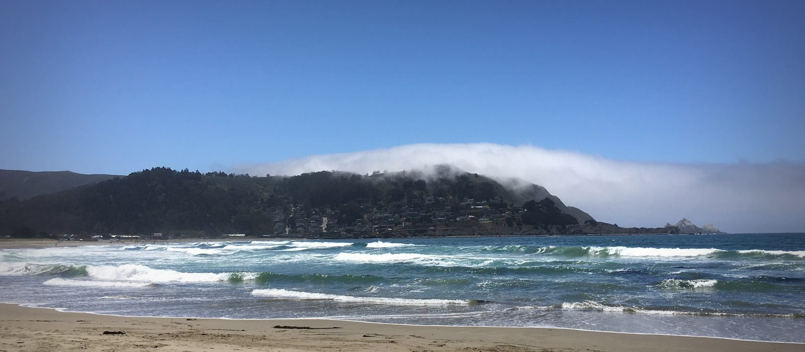 Slider – Pacifica Beach with fog on hill